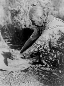 Native American Woman Preparing Food on a Stone Slab, circa 1923, Edward S. Curtis