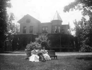 People Seated on a Bench Near Van Deusen Cottage, Kalamazoo State Mental Hospital