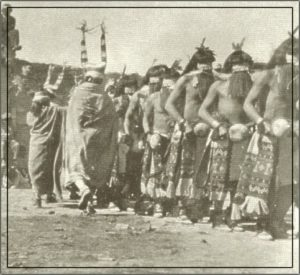 Hopi Clowns Next to a Line of Dancers in the Long Hair Dance, 1912, courtesy Museum of the American Indian, Heye Foundation