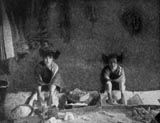 Oraibi Girls Grinding Corn, circa 1895 - 1925, courtesy Library of Congress